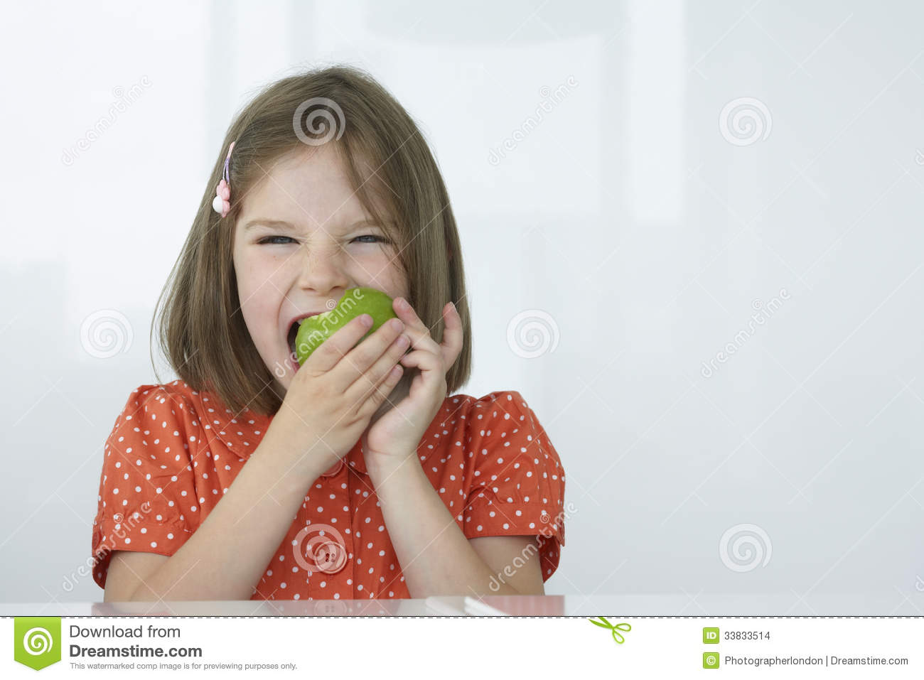 Girl Biting Green Apple