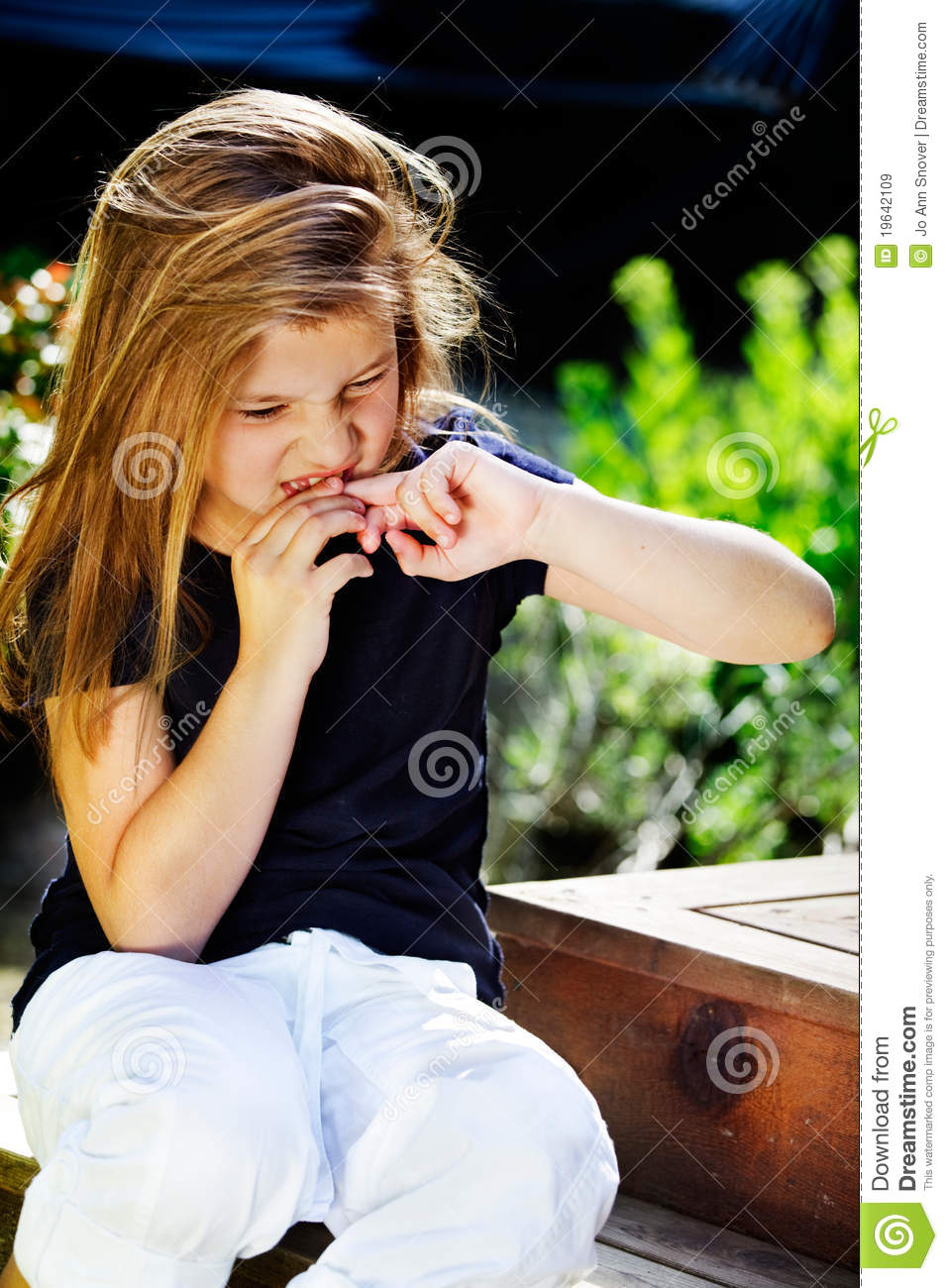 Girl Biting Nails Royalty Free Stock Images - Image: 19642109