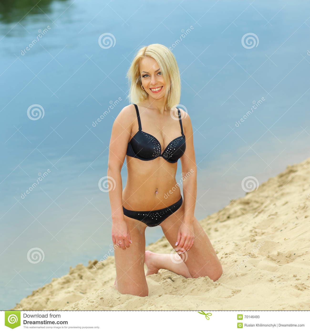 d8cccfa63051d Beautiful girl in a black bikini on the beach. Outdoor portrait of tanned girl  having fun on sun