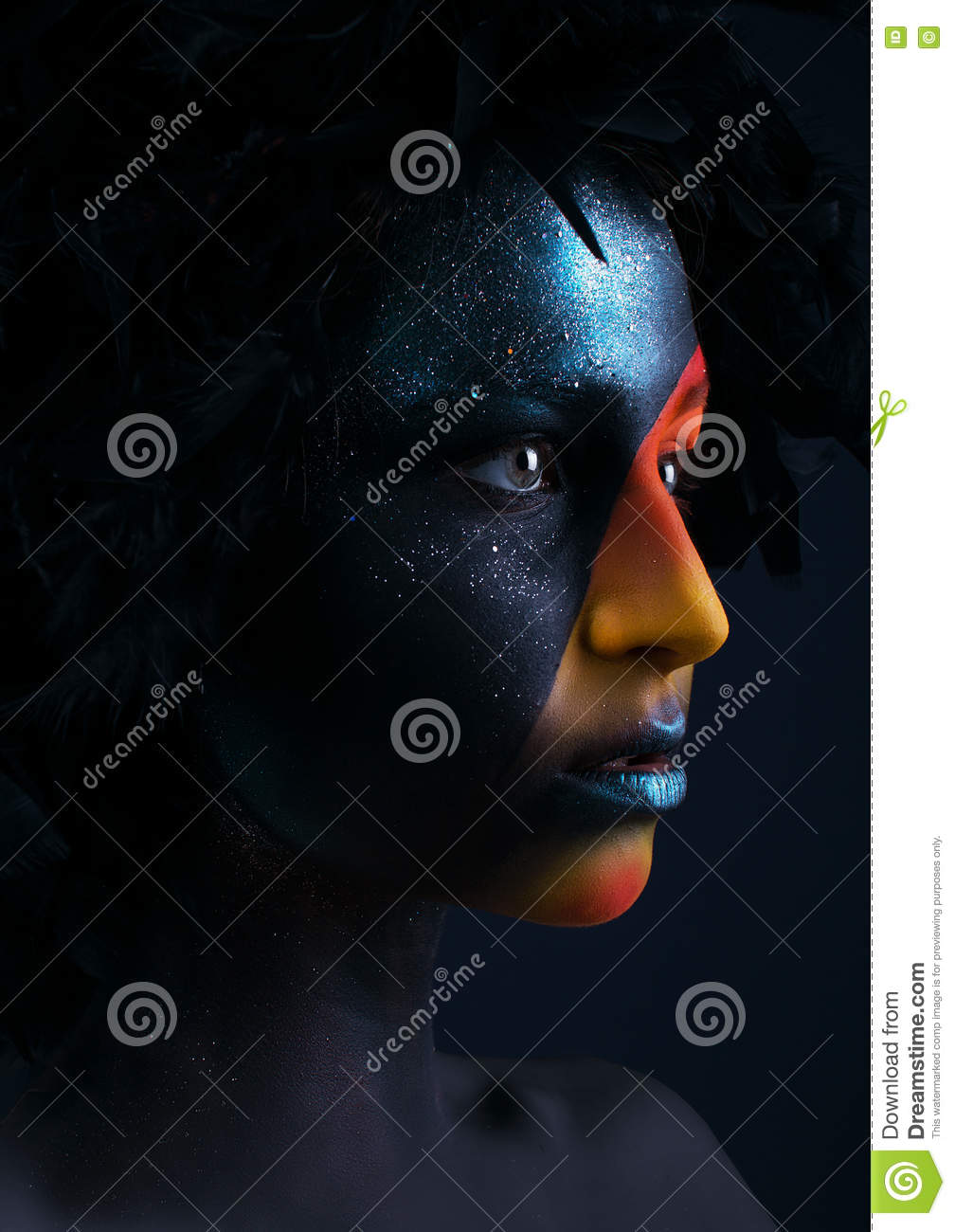 Girl with black make-up and colorful bodypainting