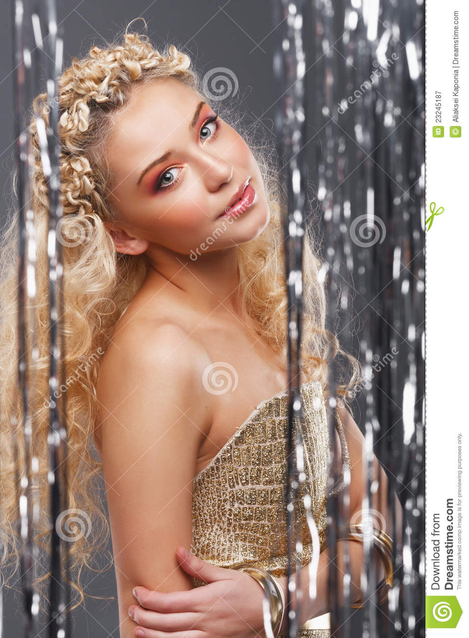 Young blonde girl with curly hair