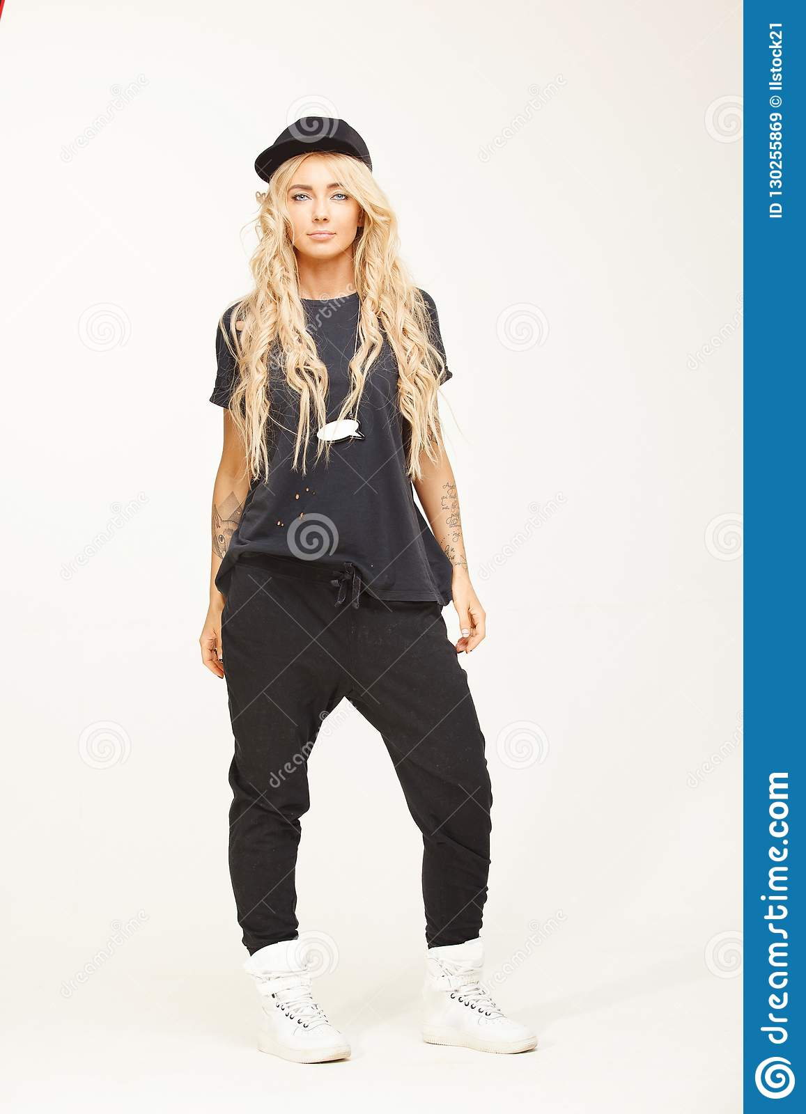 Girl With Blond Hair In Stylish Swag Clothes Isolated On