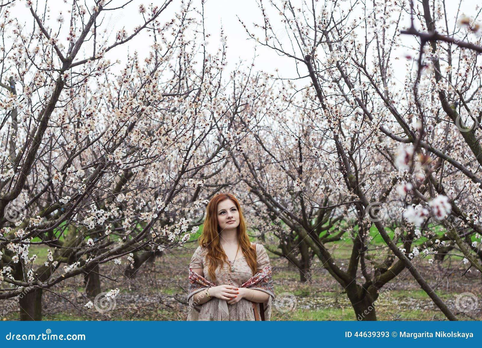 Girl in blooming gardens