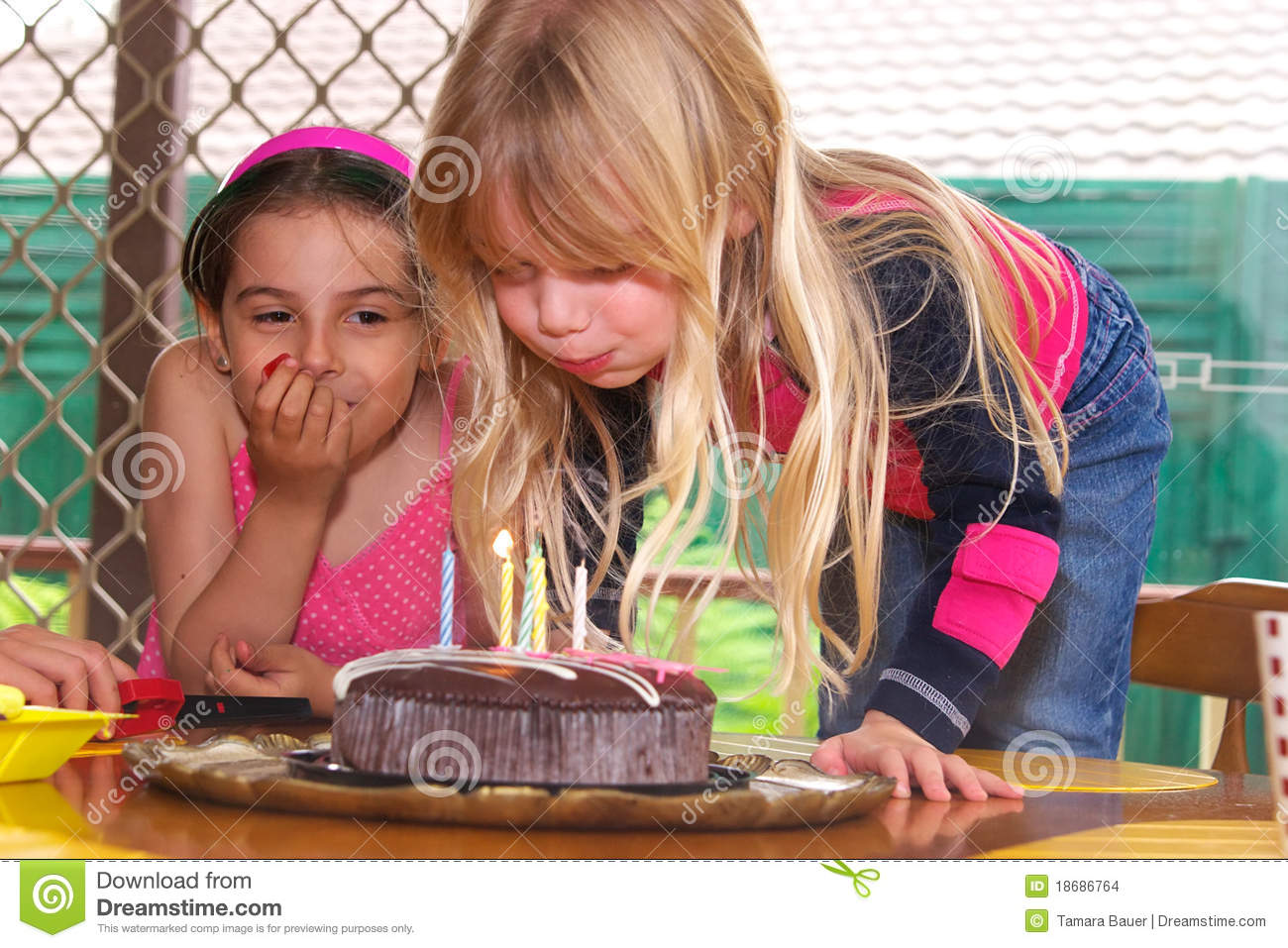 Girl Blowing Out Candles Stock Photo Image Of Pretty