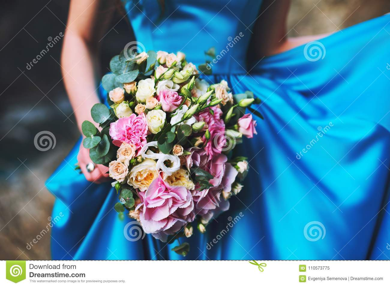 A Girl In A Blue Dress Is Holding A Wedding Bouquet Of Flowers From Roses Stock Image Image Of Hold Blue 110573775