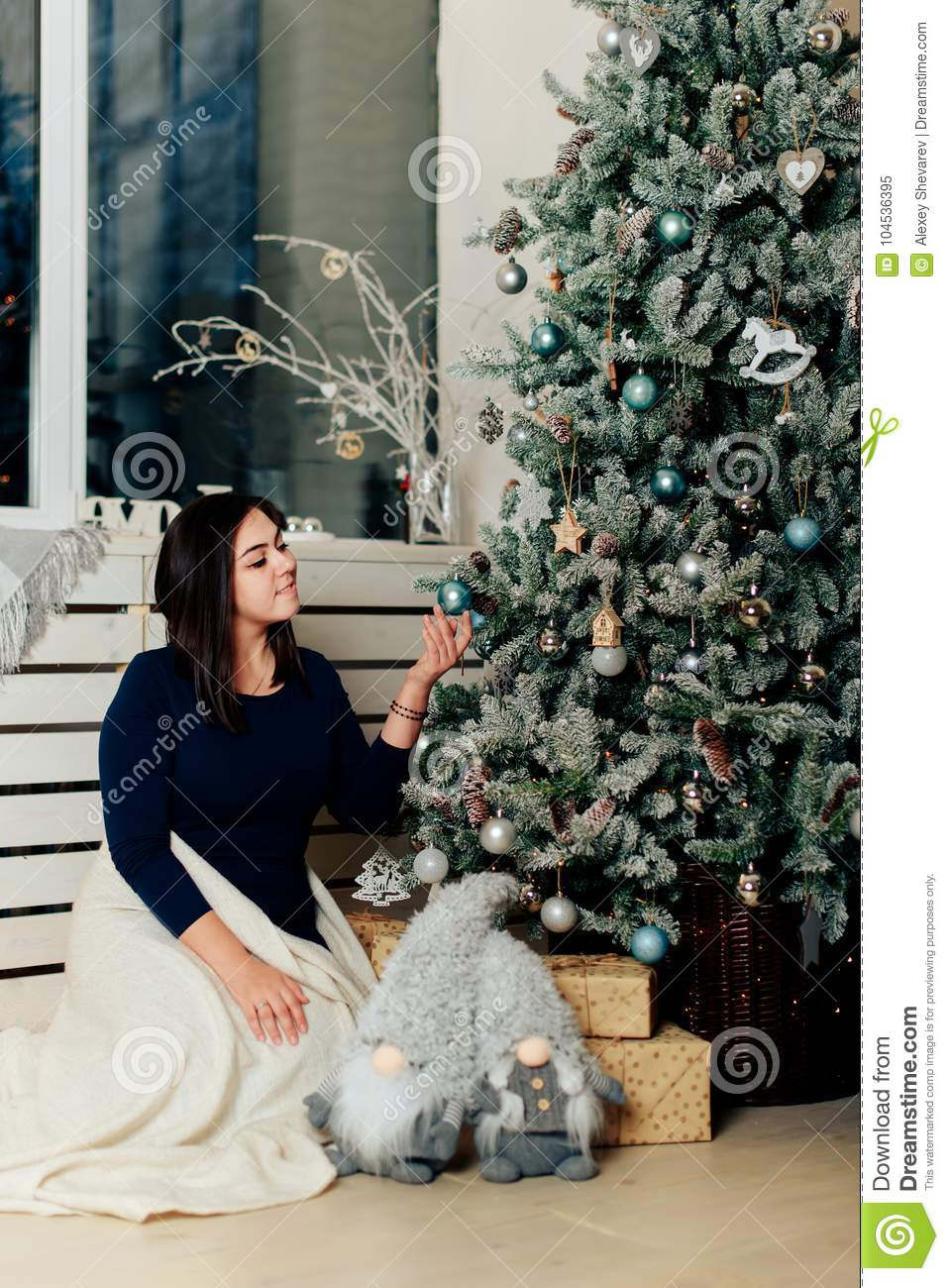 Girl In A Blue Dress In A New Year Decor Near A Decorated ...