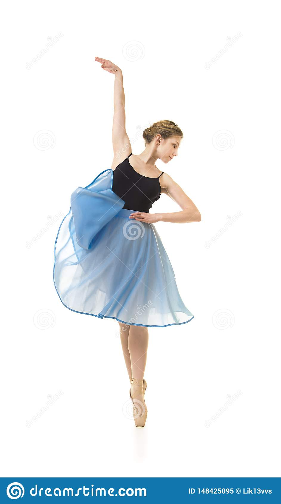 Girl in a blue skirt and a black leotard dance ballet