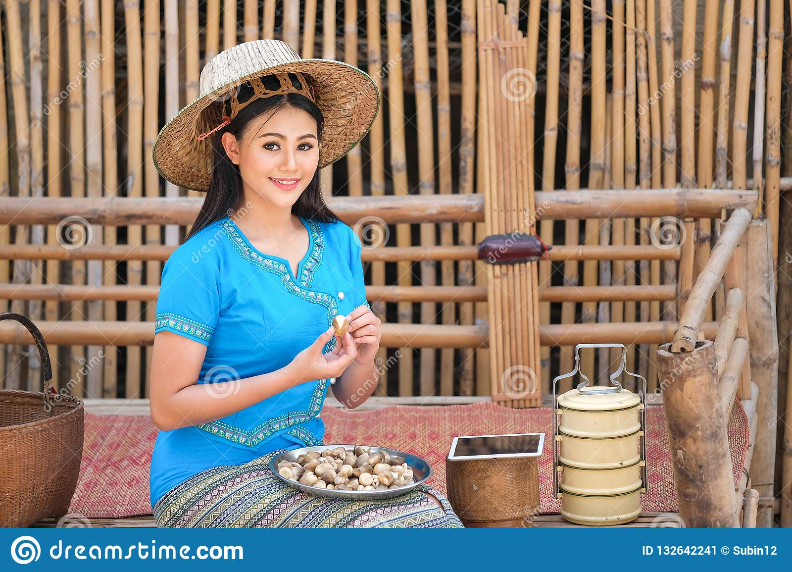 18eb0fea1 The Girl In A Blue Traditional Thai Style Dress Is Picking Stock ...