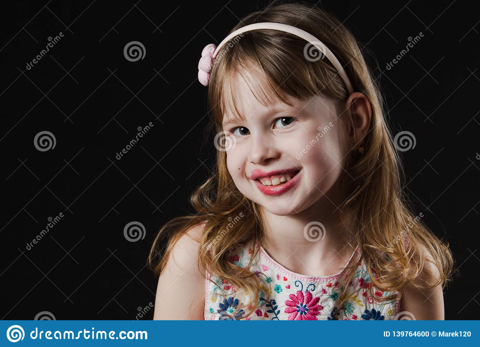 Smiling girl with blurred lips