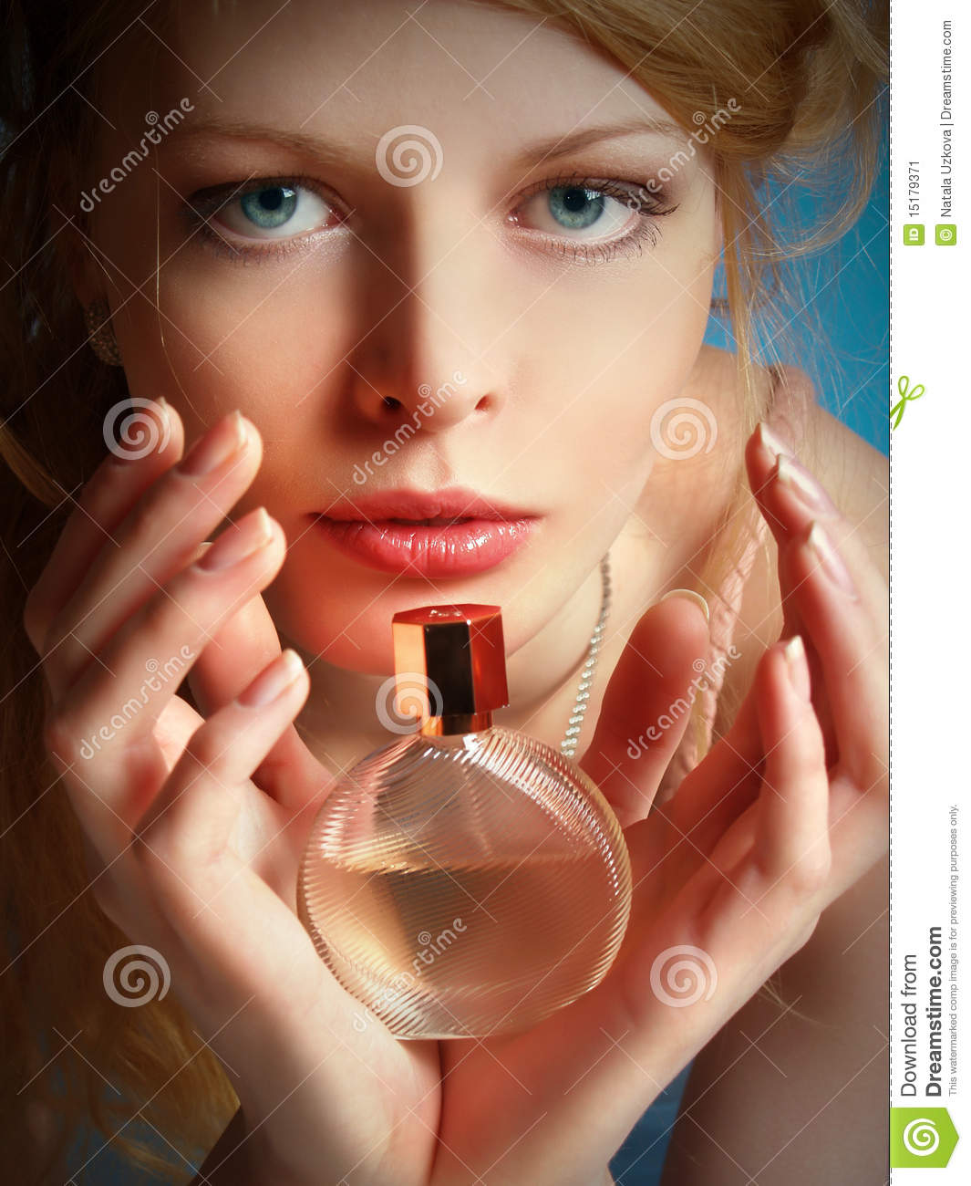 Girl with a bottle of perfume in her hands