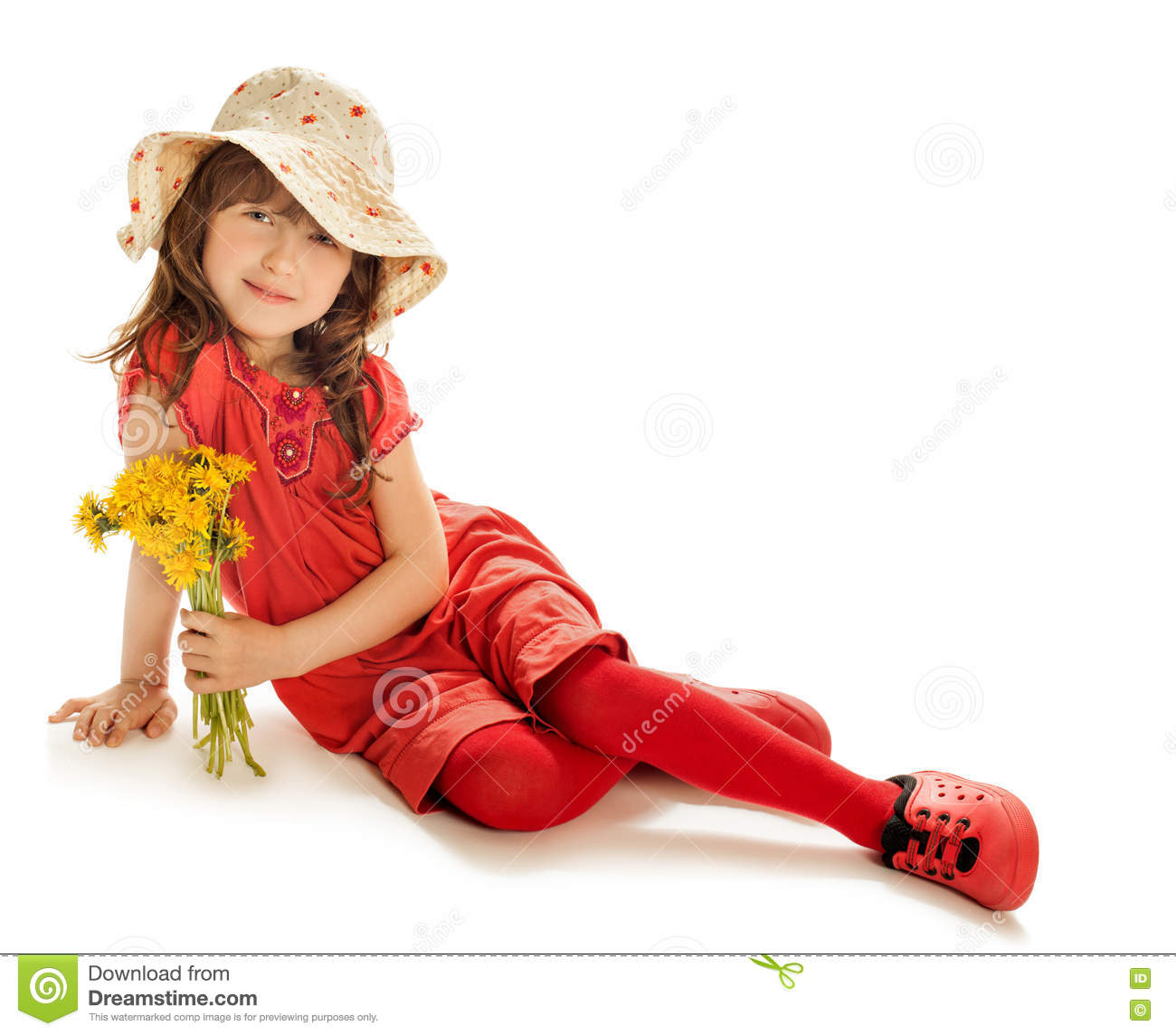 ab665246d3605 Cute little girl in a red summer dress and beach hat sitting on the floor ,  and holding a bouquet of yellow flowers , dandelions - Isolated on white ...