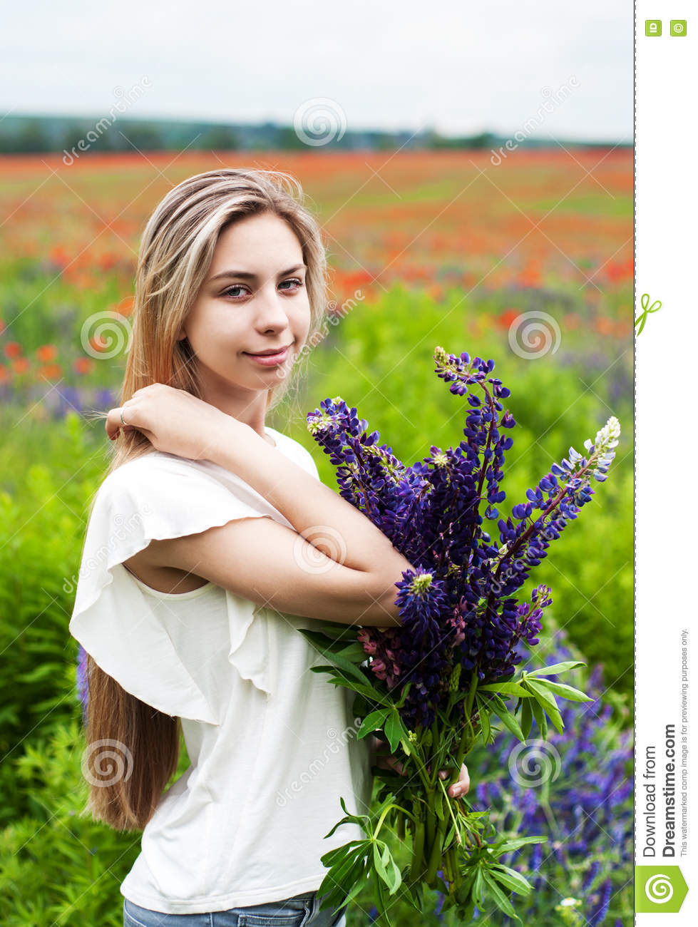 Girl with bouquet of lupine flowers