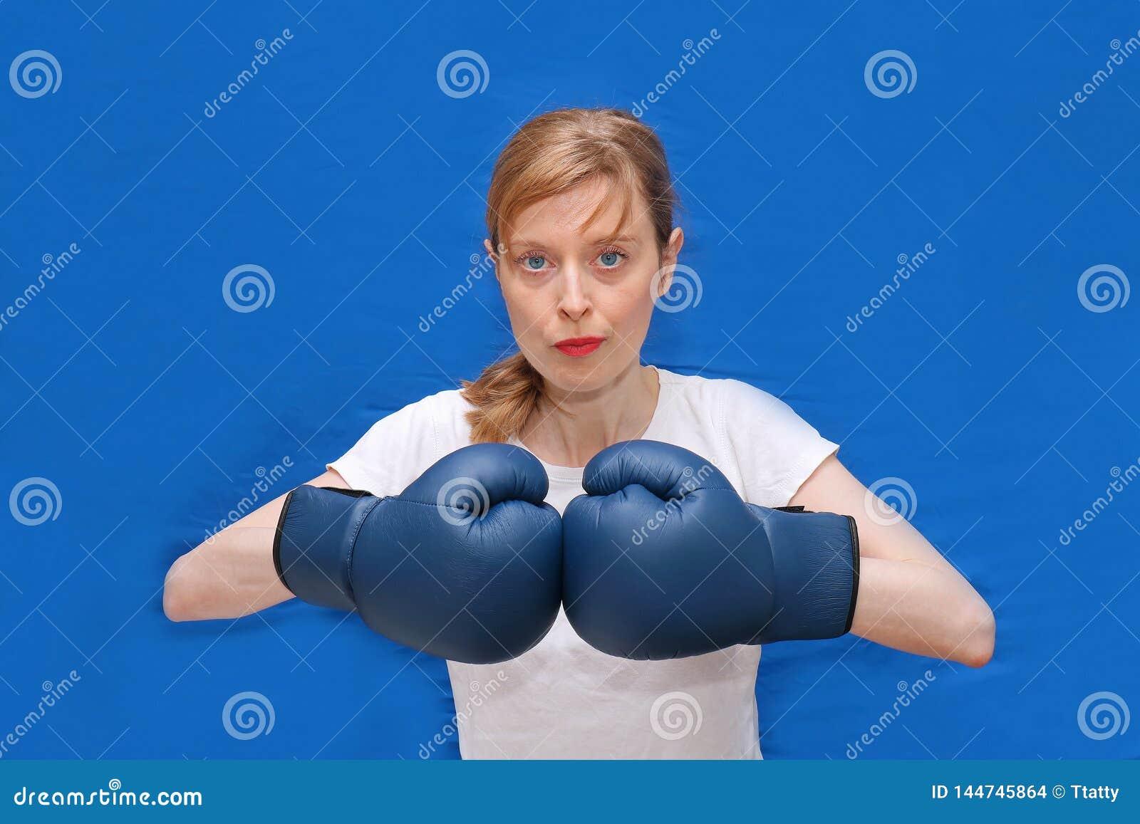Girl boxer in blue arena
