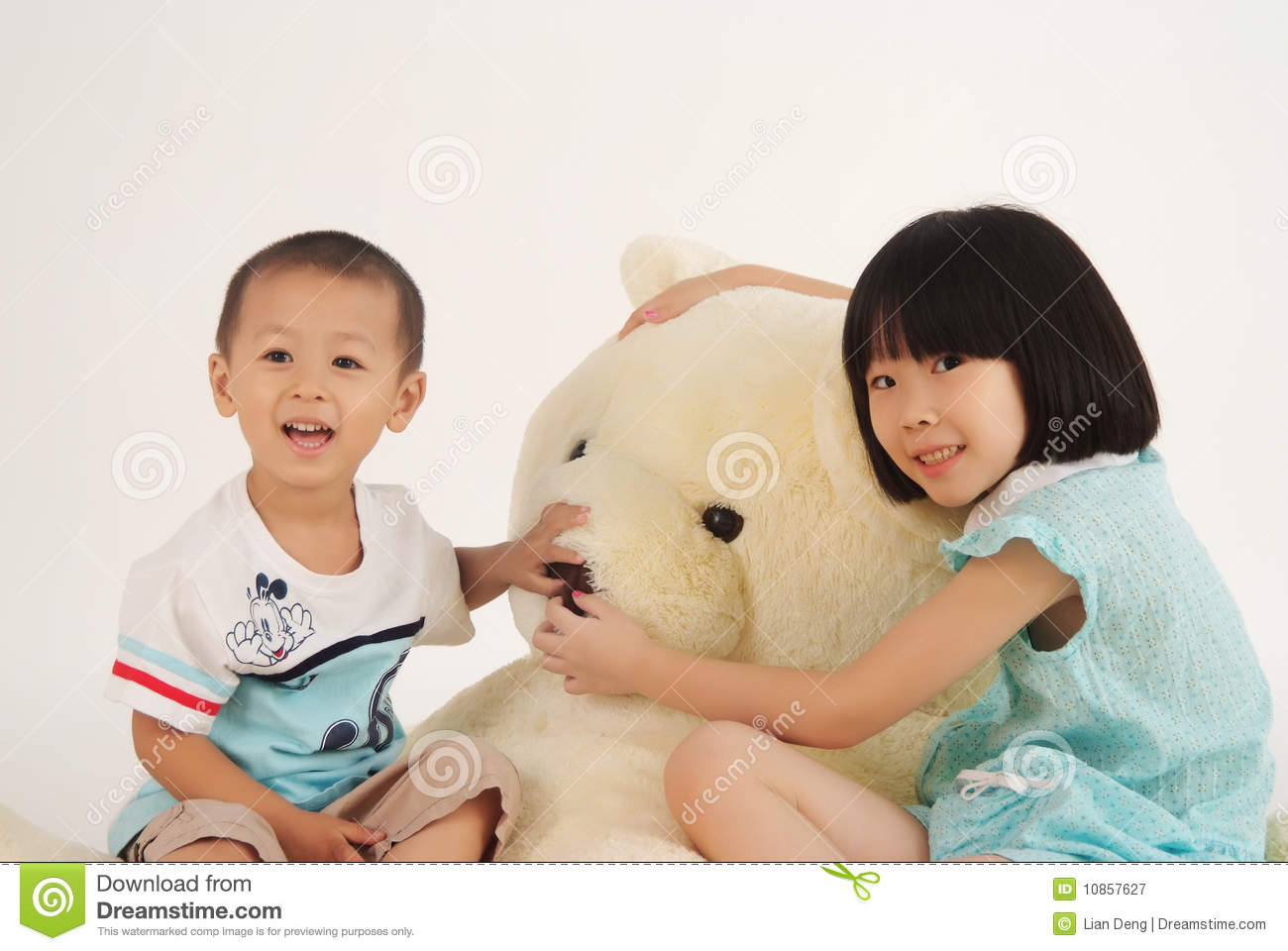 Girl and boy with bear toy