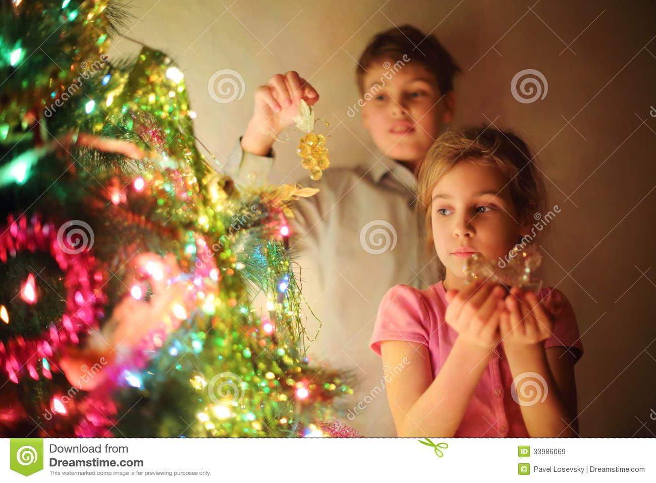 Boy Toys Christmas : Girl and boy decorated christmas tree by glass toys at