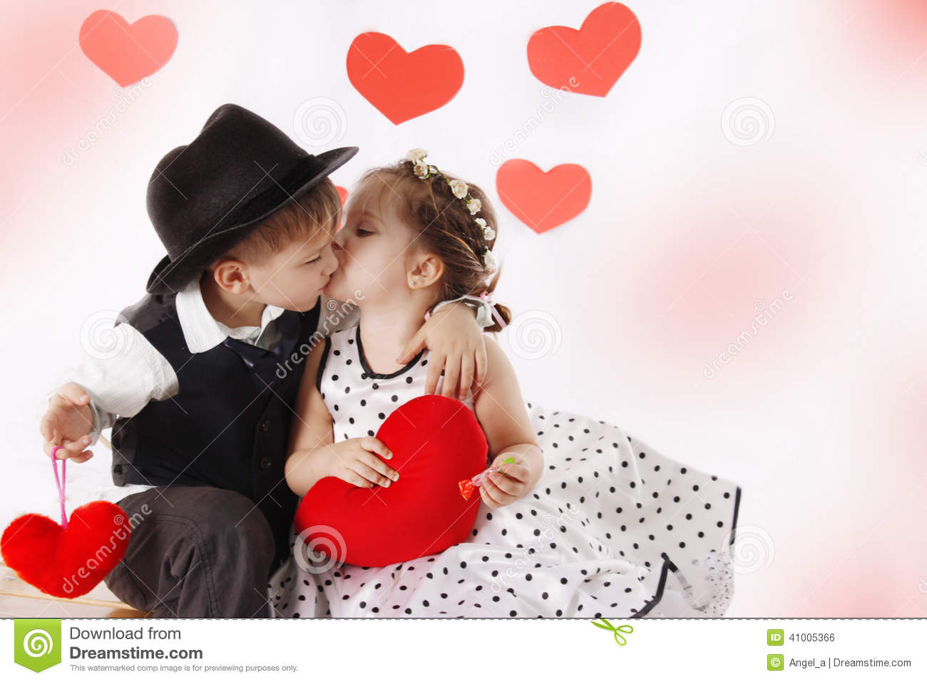 Girl And Boy Kissing And Holding Hearts Stock Photo - Image of ...