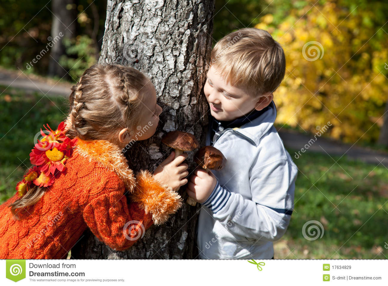 A Girl And A Boy Are Playing Hide And Seek Royalty Free