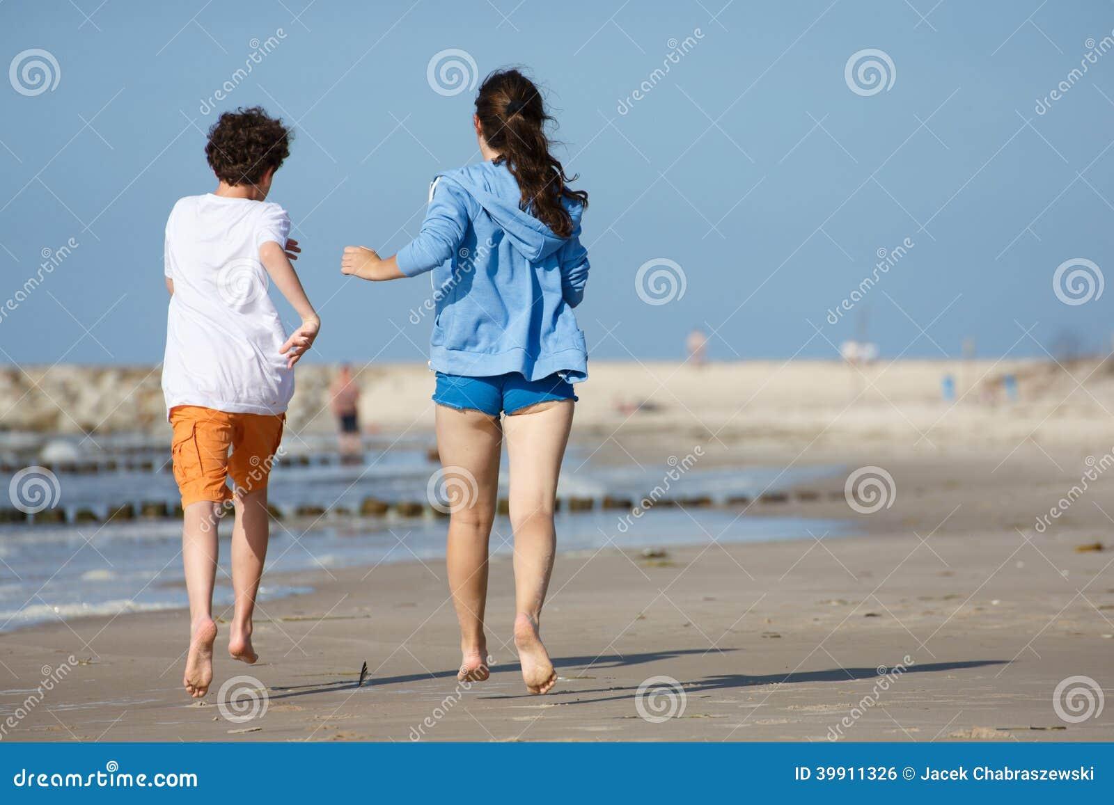 Girl And Boy Running On Beach Stock Photo - Image: 39911326 Girl Running On Beach