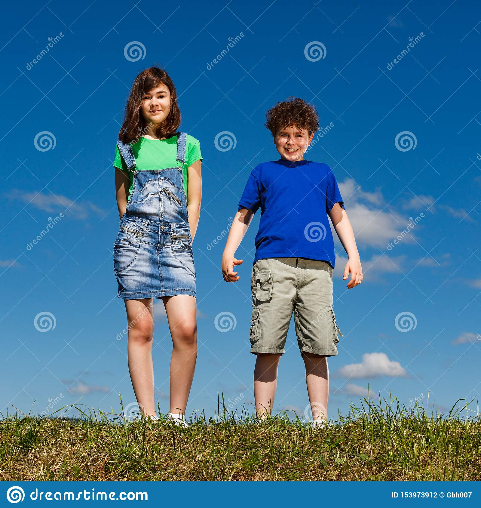 Girl and boy standing outdoor