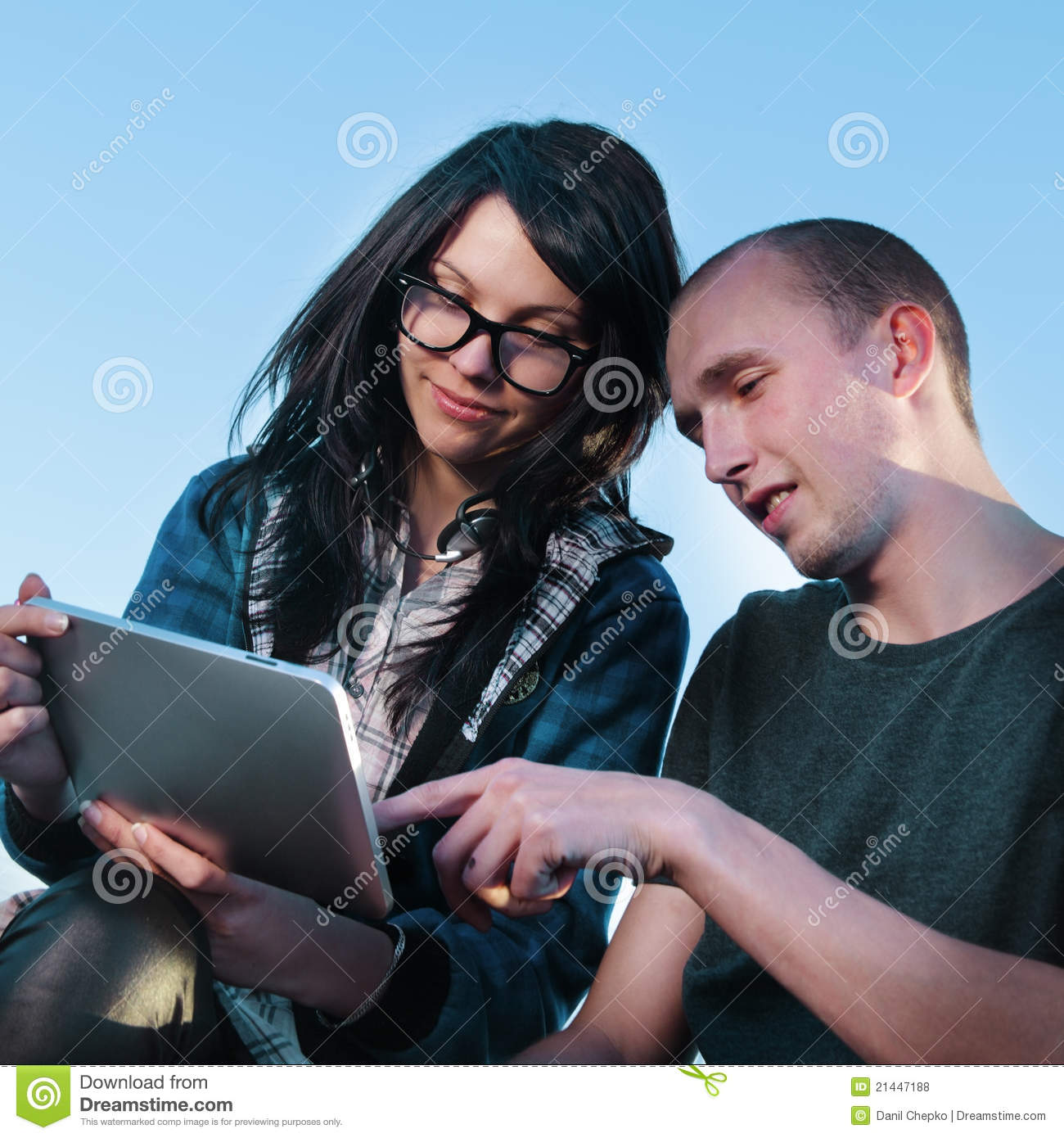 Girl and boy with tablet pc