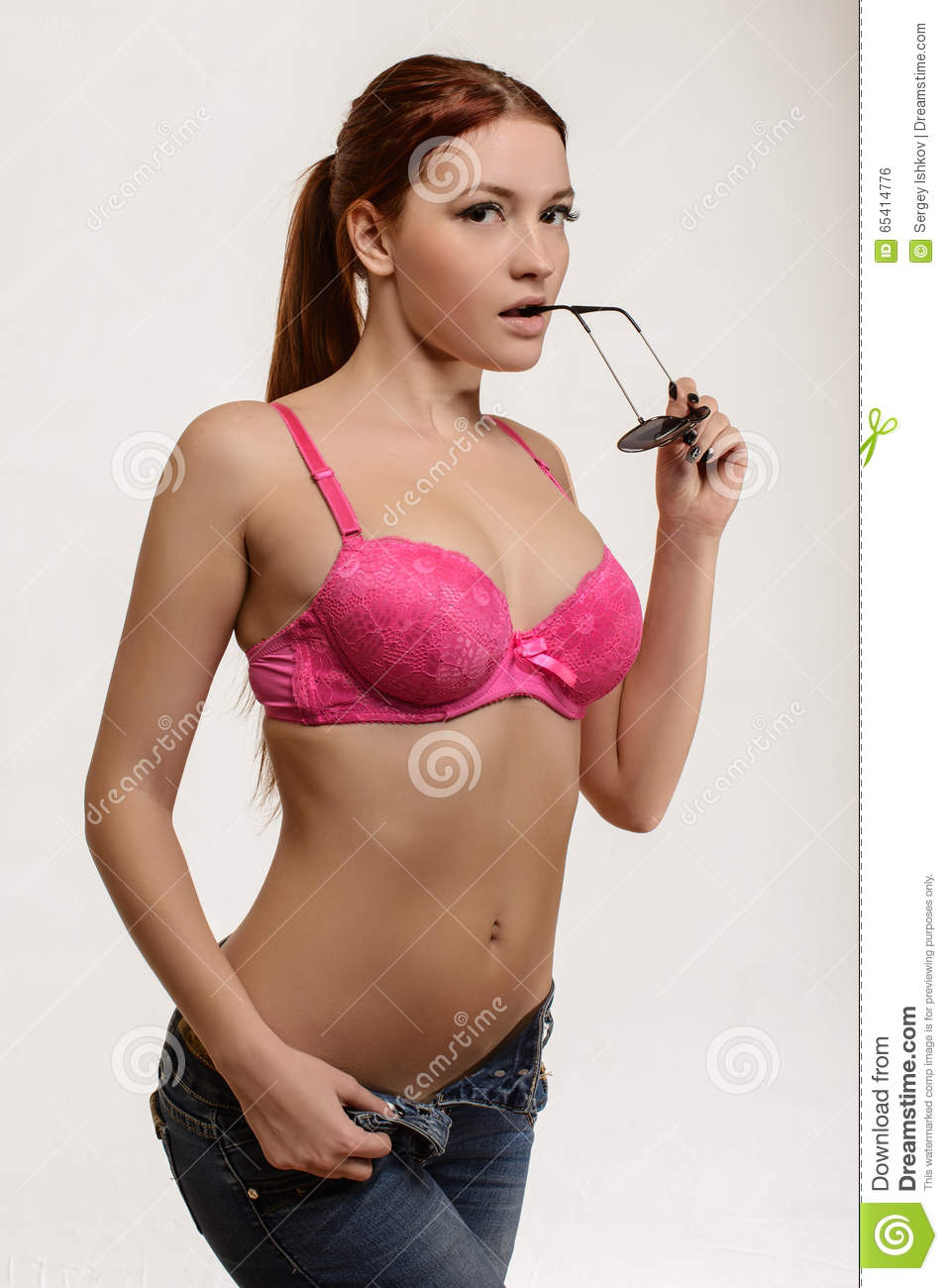 Girl In A Bra And Jeans, Sunglasses Stock Photo