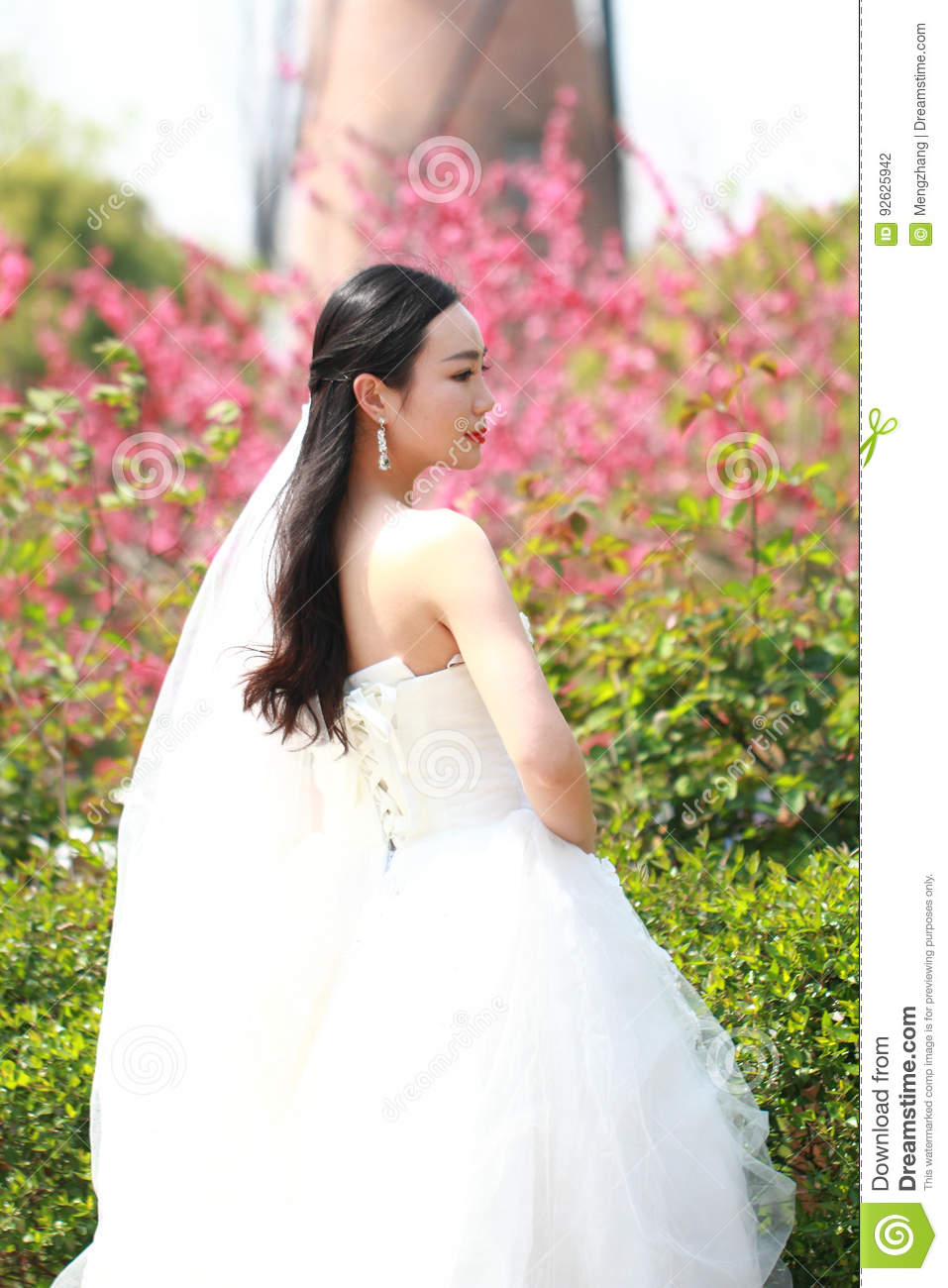 Girl Bride In Wedding Dress With Elegant Hairstyle With White