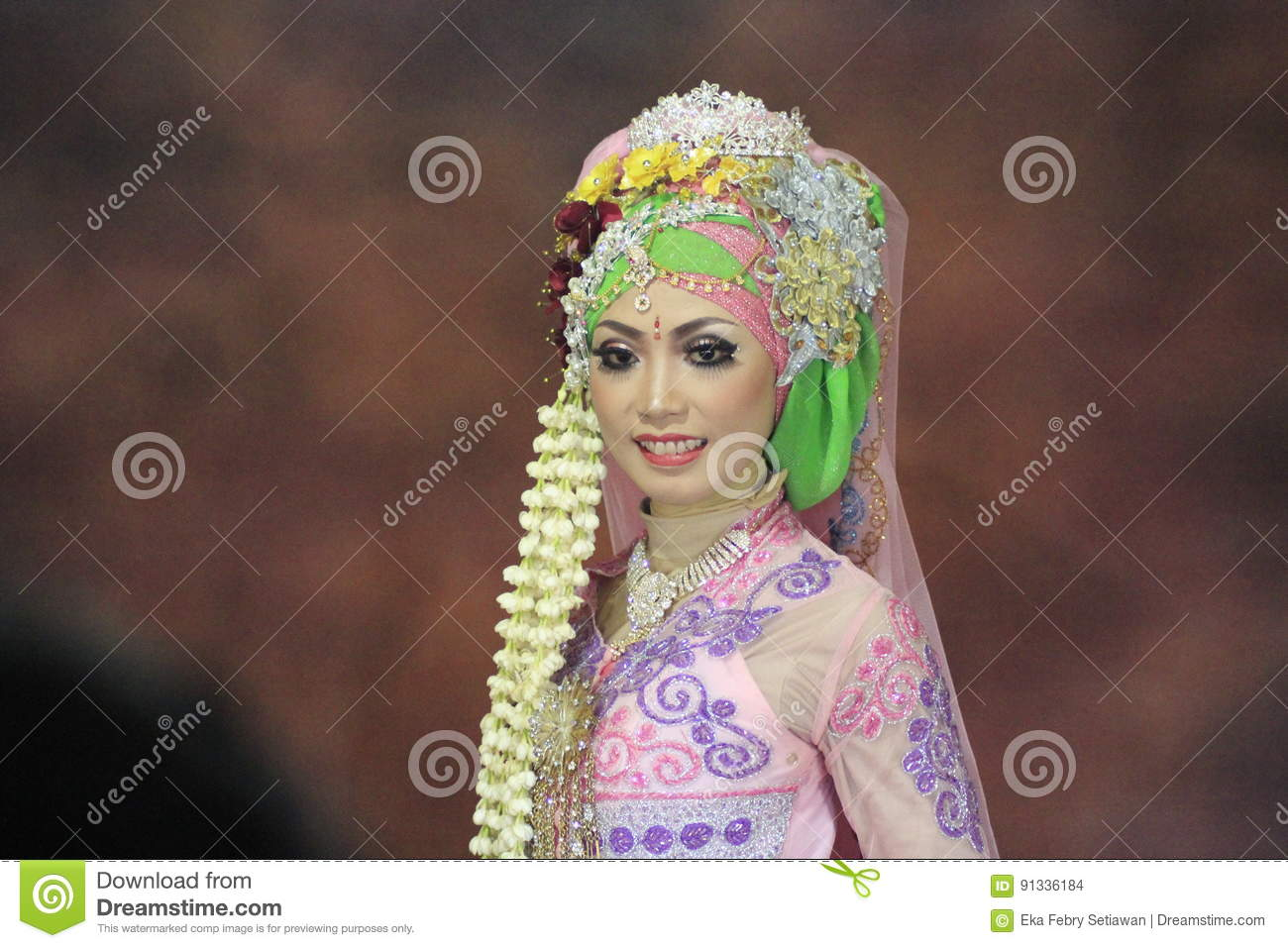 Girl bride in wedding dress traditional of java