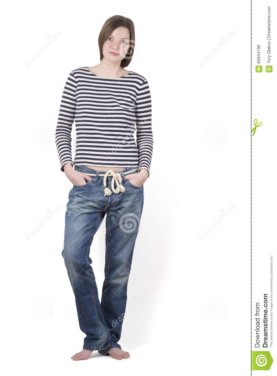 4199c531a99 Girl Brunette Standing Barefoot In A Striped Shirt And Blue Jeans ...