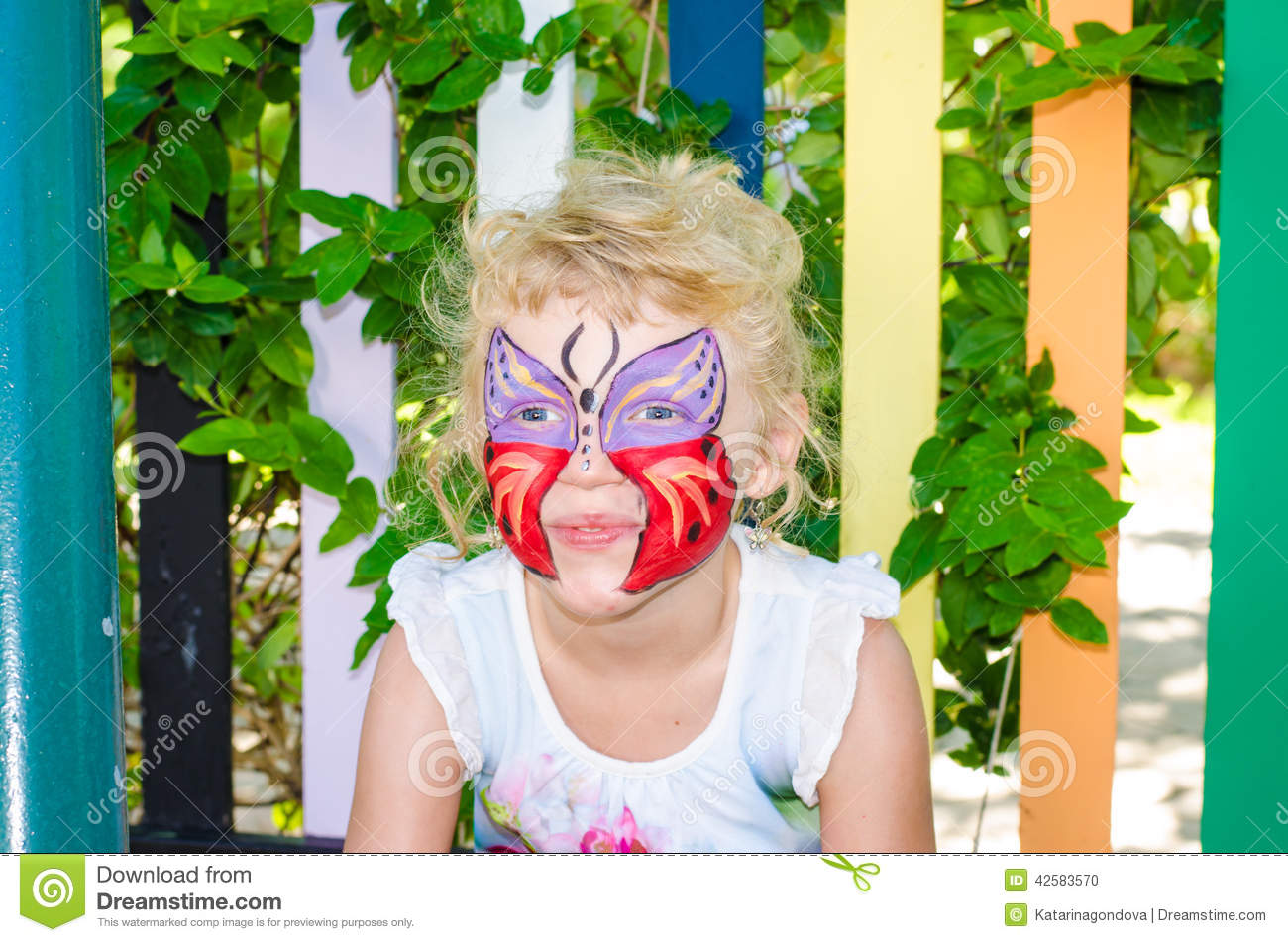 Girl with butterfly face painting
