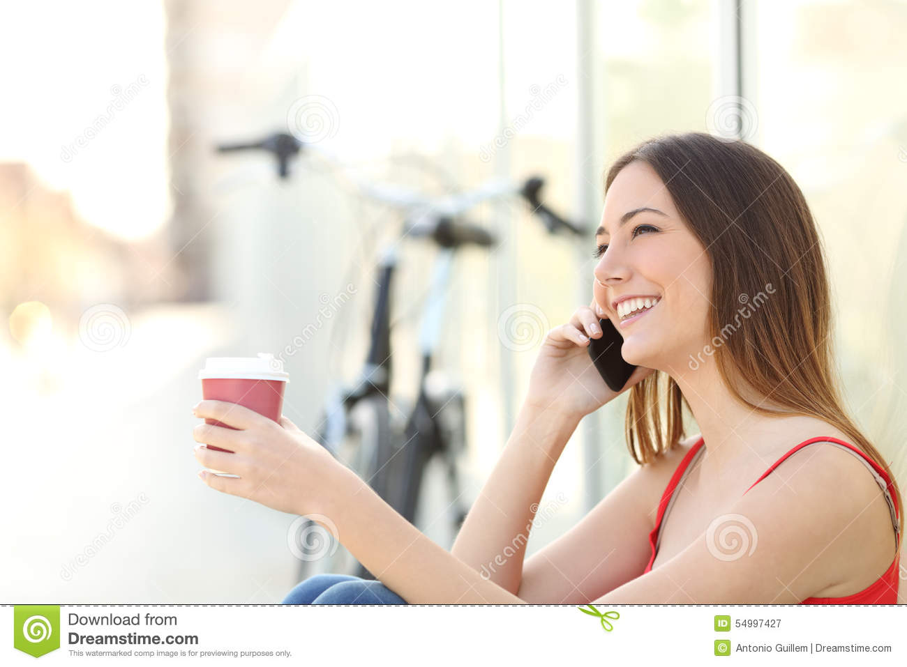 Girl Drinking Coffee Looking At Phone