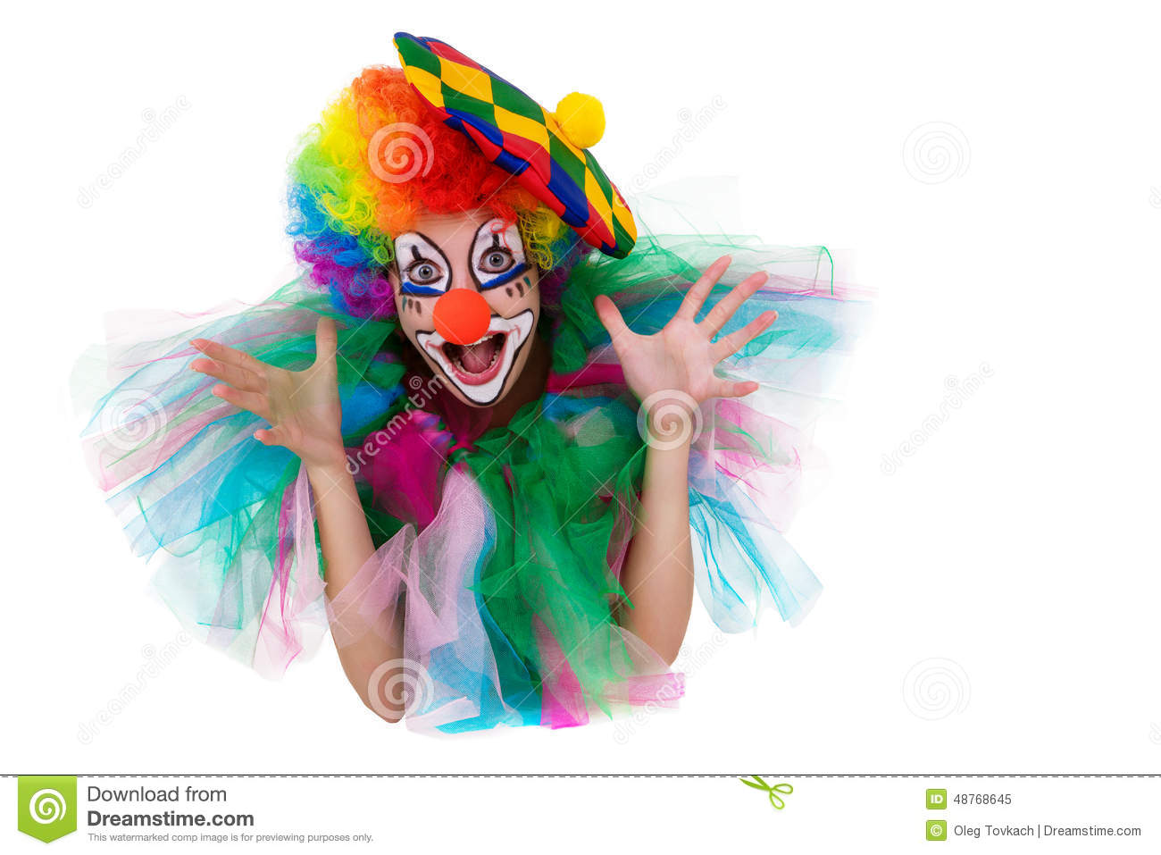 Girl In Cap And Clown Costume With A Bouquet Of Flowers Puts Out The