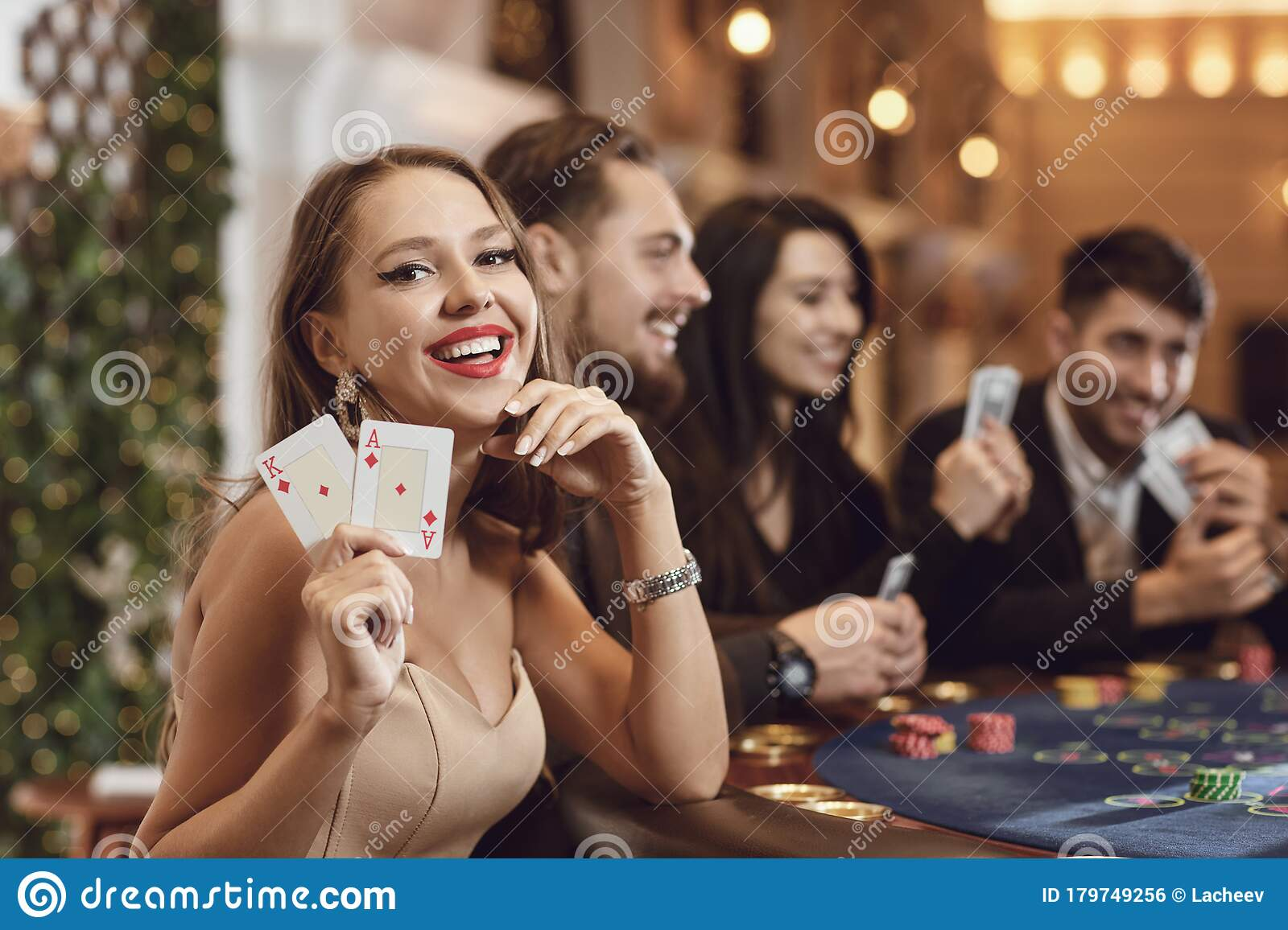 Girl With Cards In Her Hands Smiles At Winning Poker In A Casino. Stock  Photo - Image of blackjack, gambling: 179749256