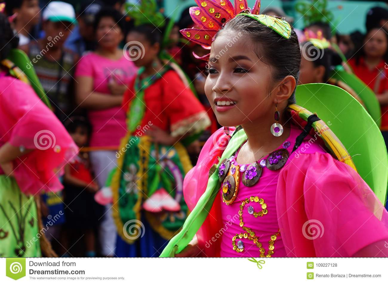 Girl carnival dancer in ethnic costumes dances in delight along the road