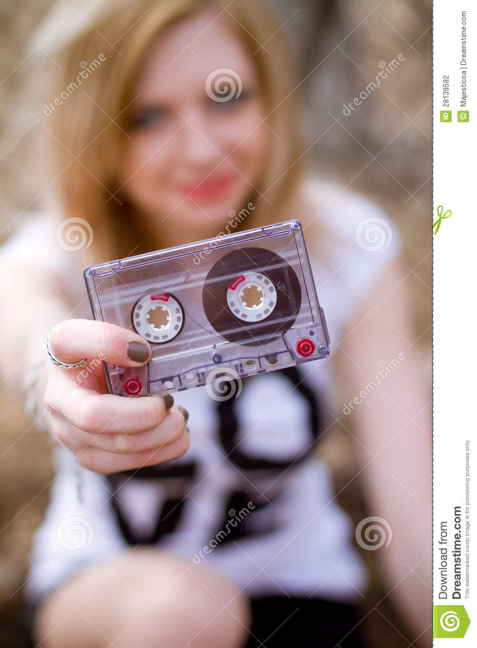 Girl with a cassette in her hand
