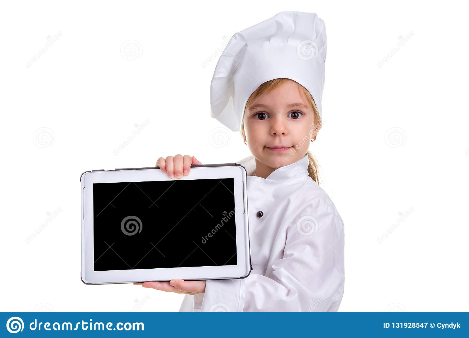 Girl chef white uniform isolated on white background. Showing the empty black ipad screen, looking at the camera