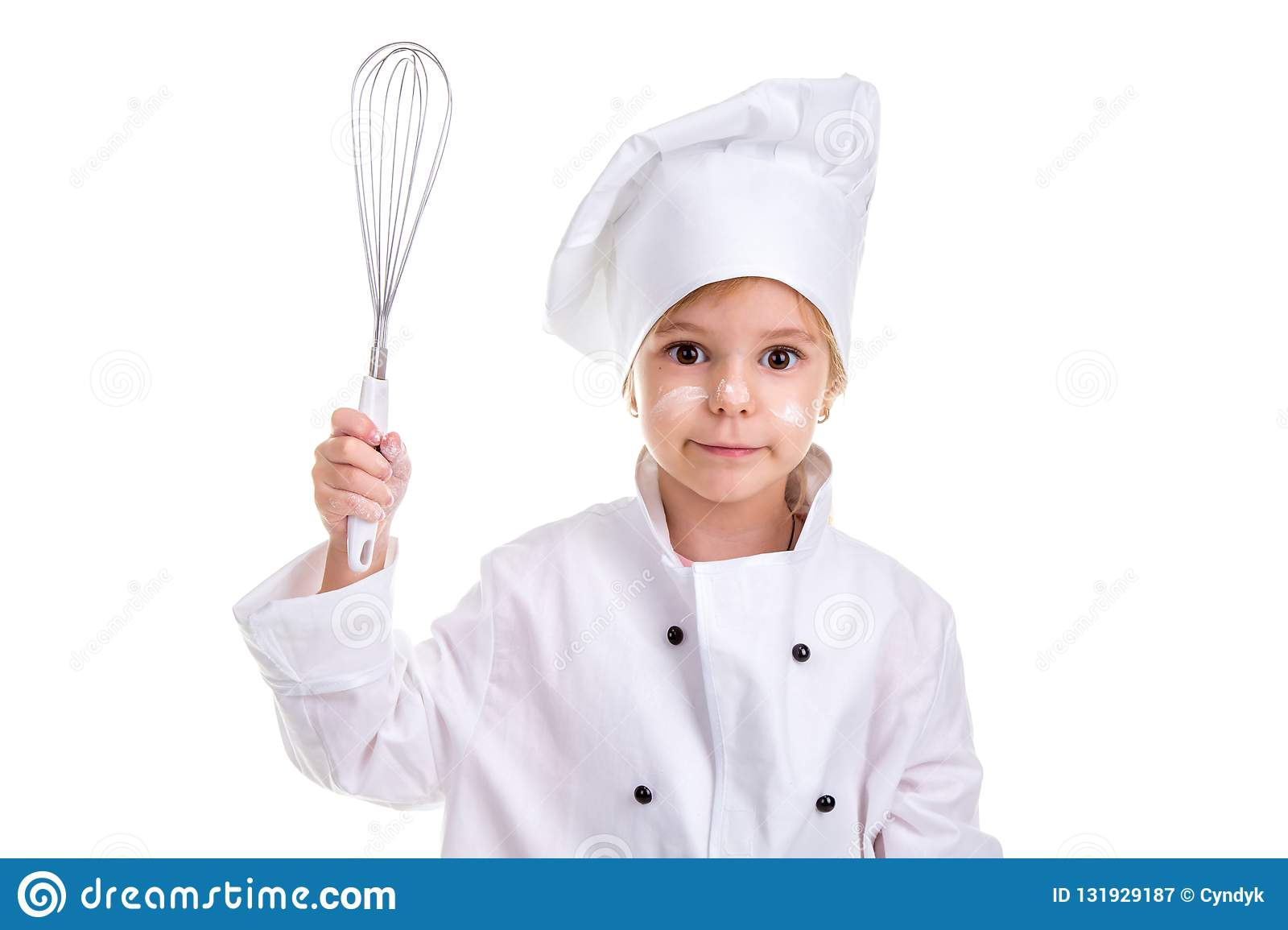 Girl chef white uniform isolated on white background. Floured face. Holding the whisk in one hand. Landscape image