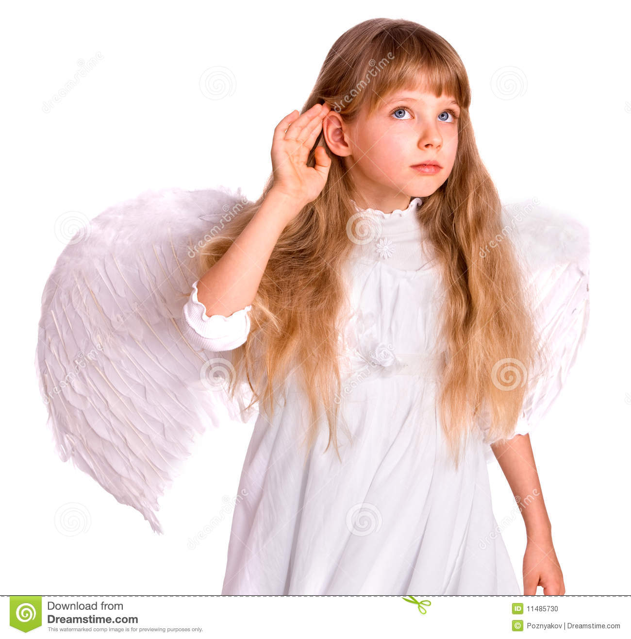 Girl child in angel costume listen, hand near ear.