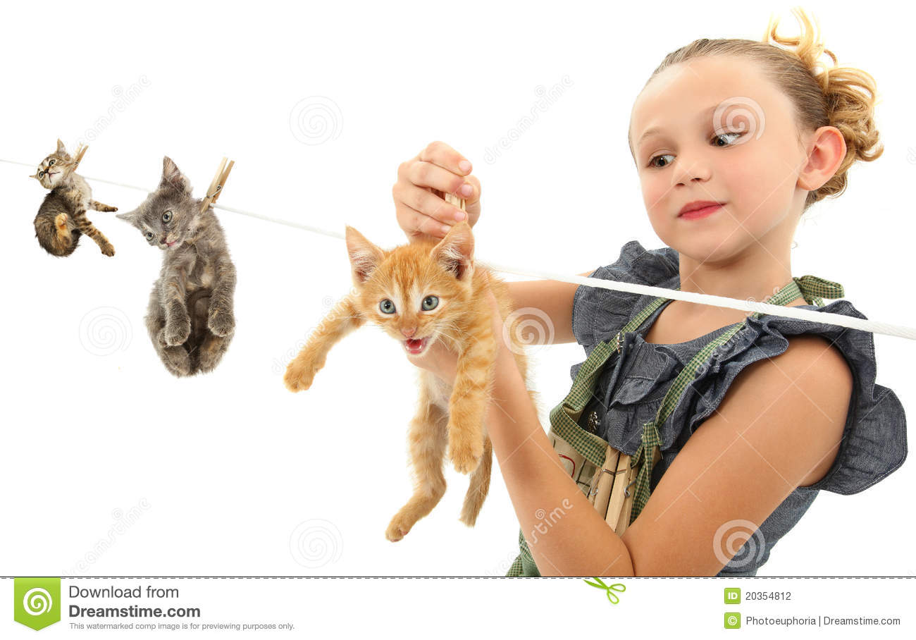 Girl Child Hanging Kittens On Clothes Line Stock Photography - Image ...