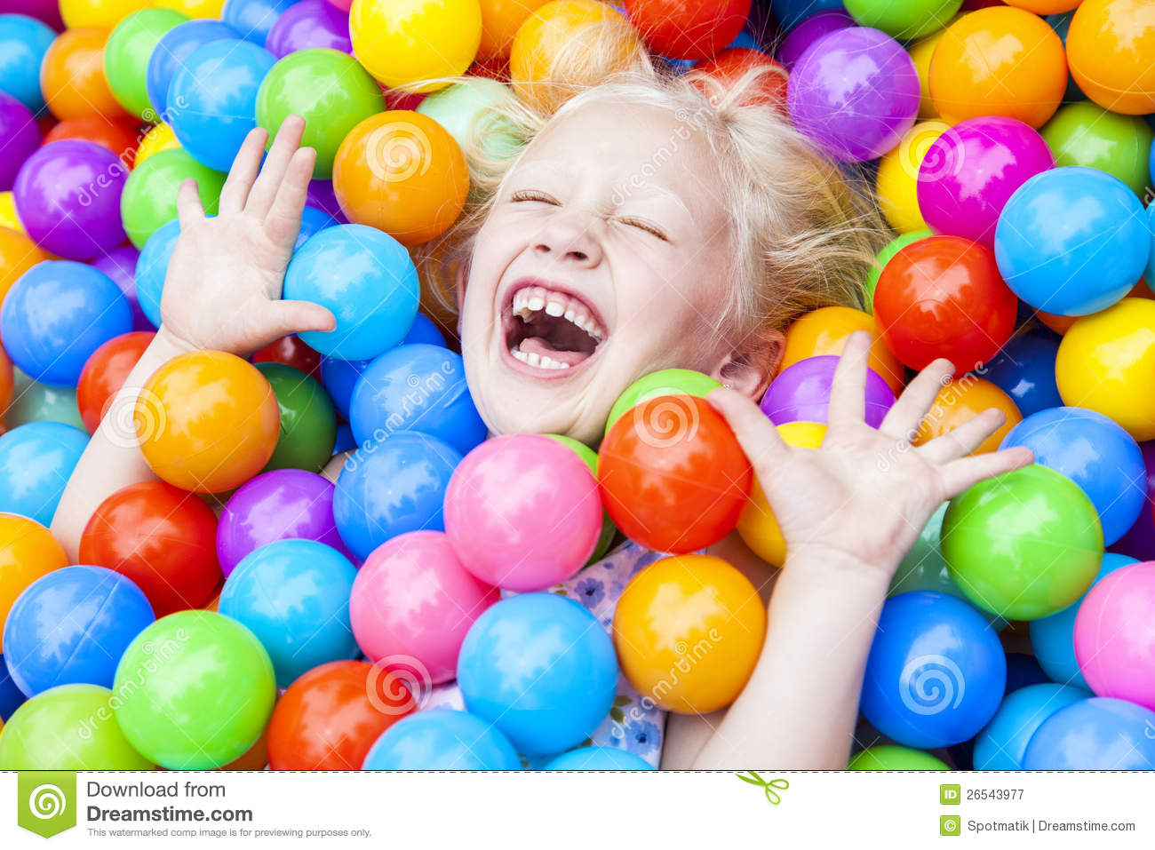 girl child having fun playing in colored balls - Fun Kid Pictures