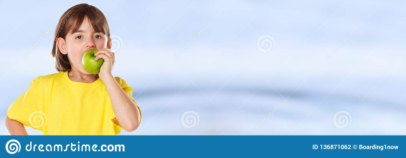 Girl child kid eating apple fruit autumn fall healthy copyspace banner