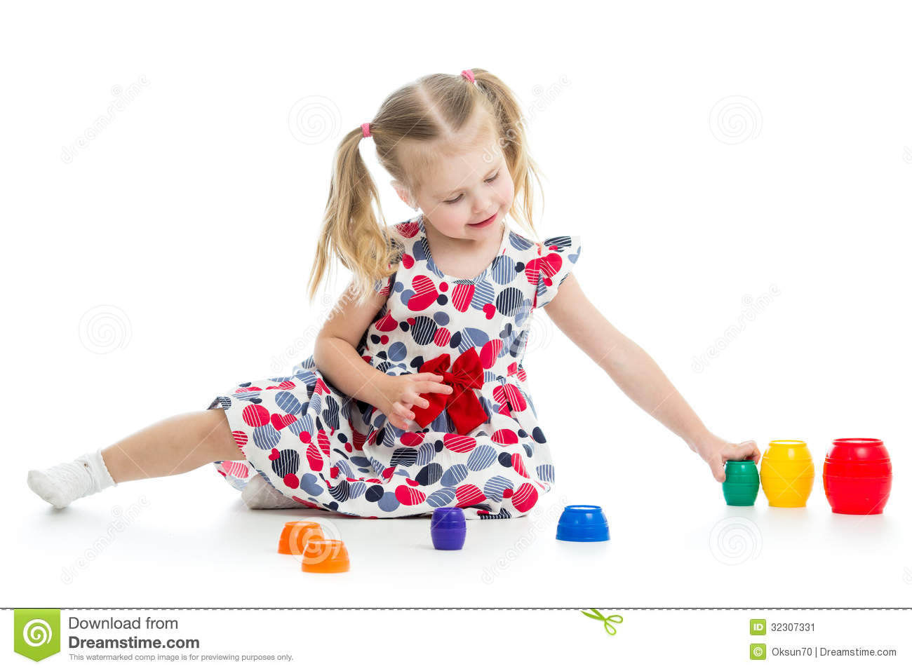 Girl Child Playing With Cup Toys Stock Image - Image: 32307331