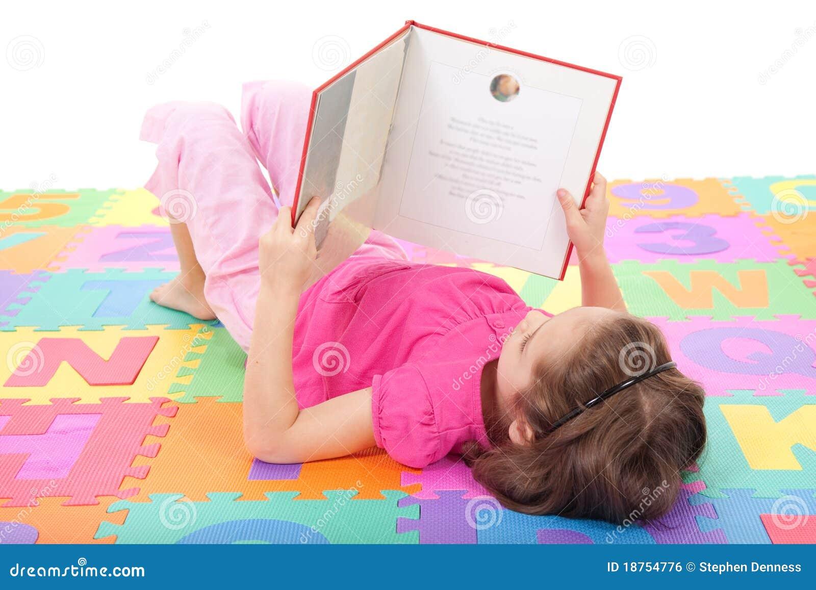 child reading kids book on alphabet royalty free stock image