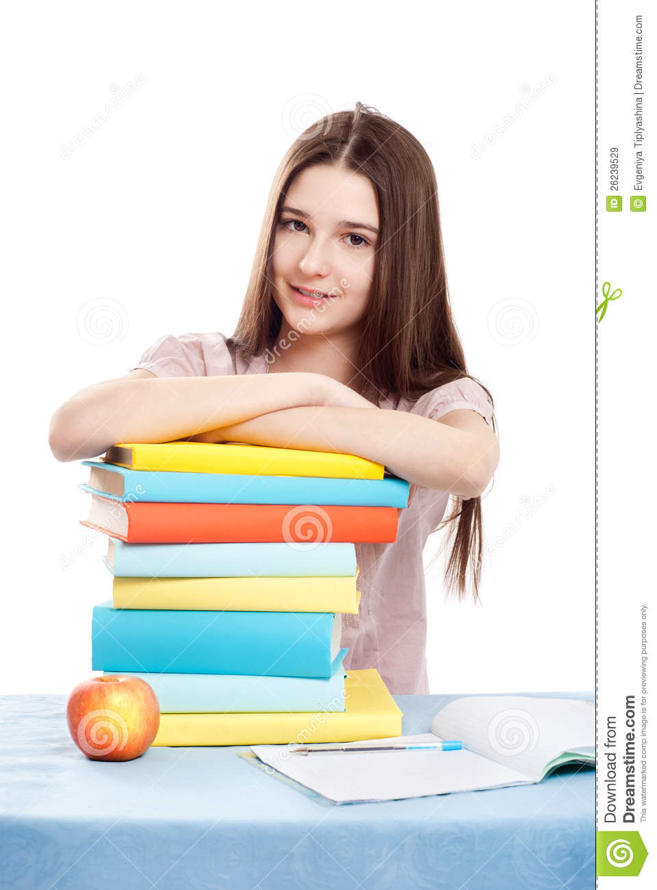 The girl child at the table with books