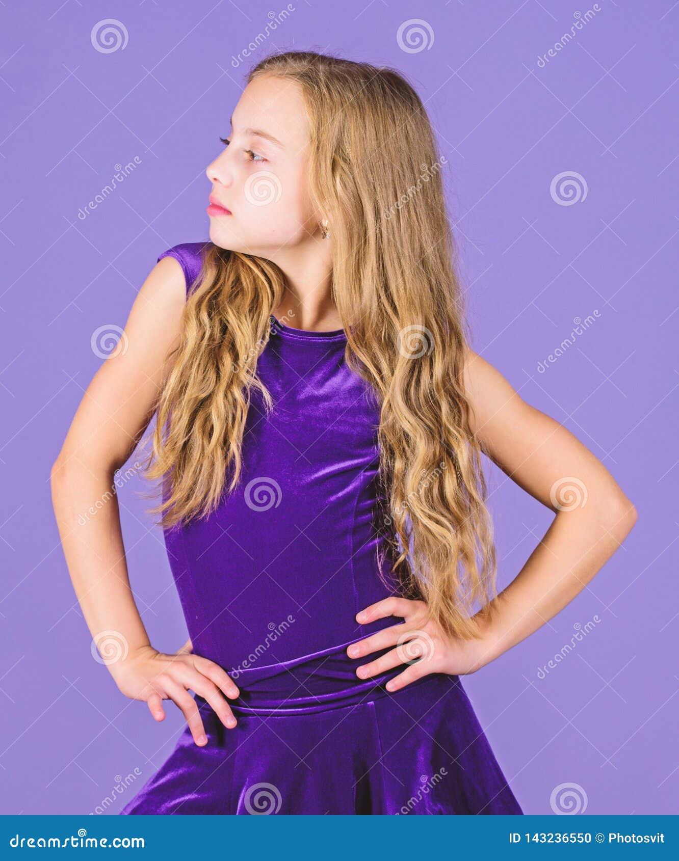 Girl child wear velvet violet dress. Clothes for ballroom dance. Kid fashionable dress looks adorable. Ballroom