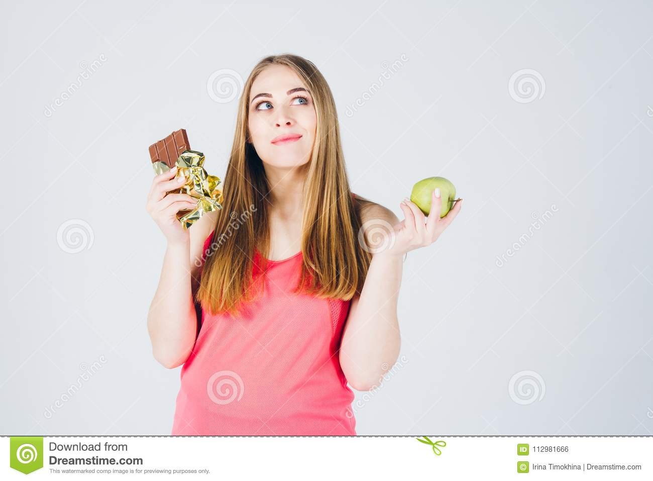 Girl chooses between Apple and chocolate