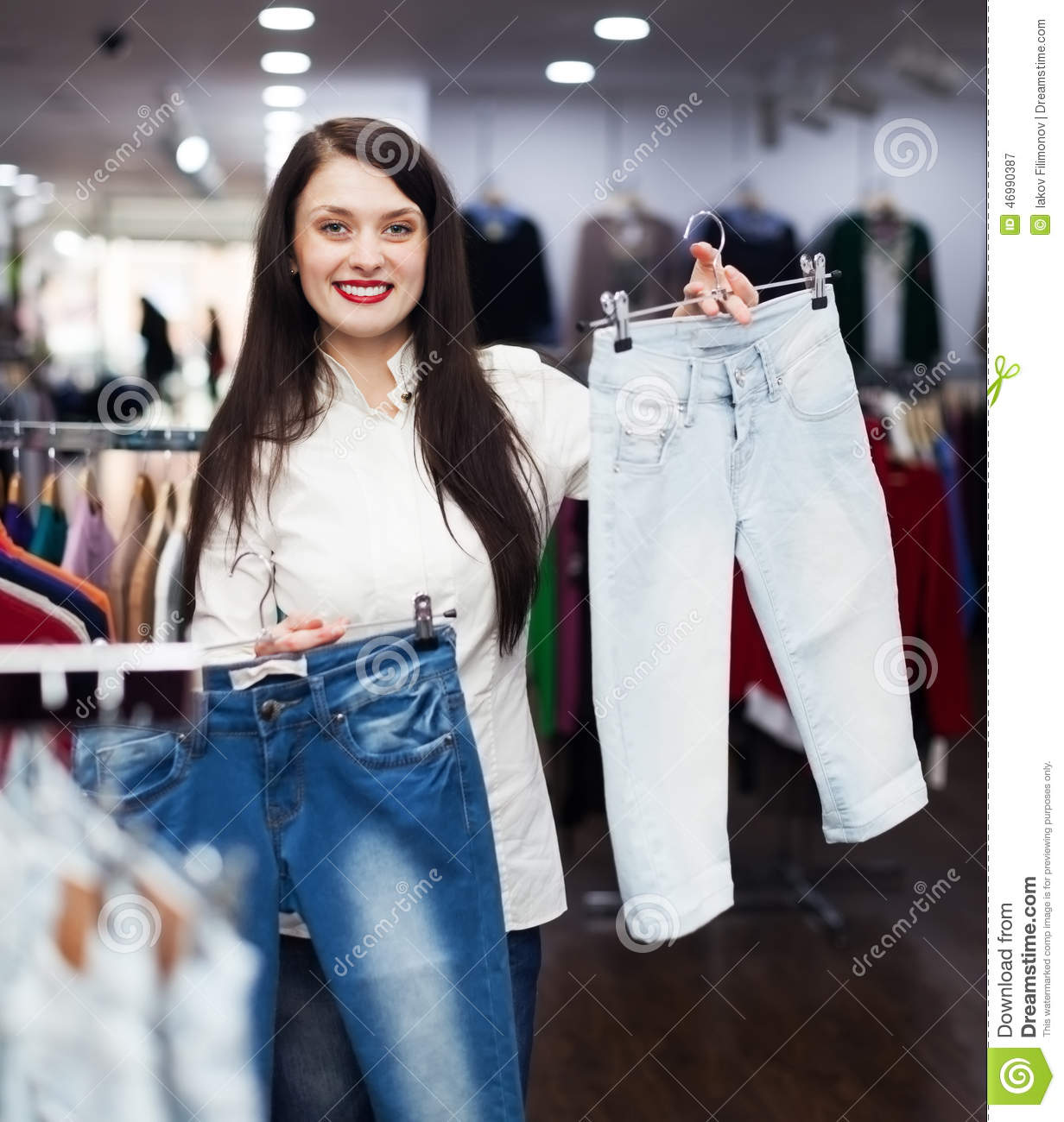 Girl Choosing Jeans At Store Stock Photo