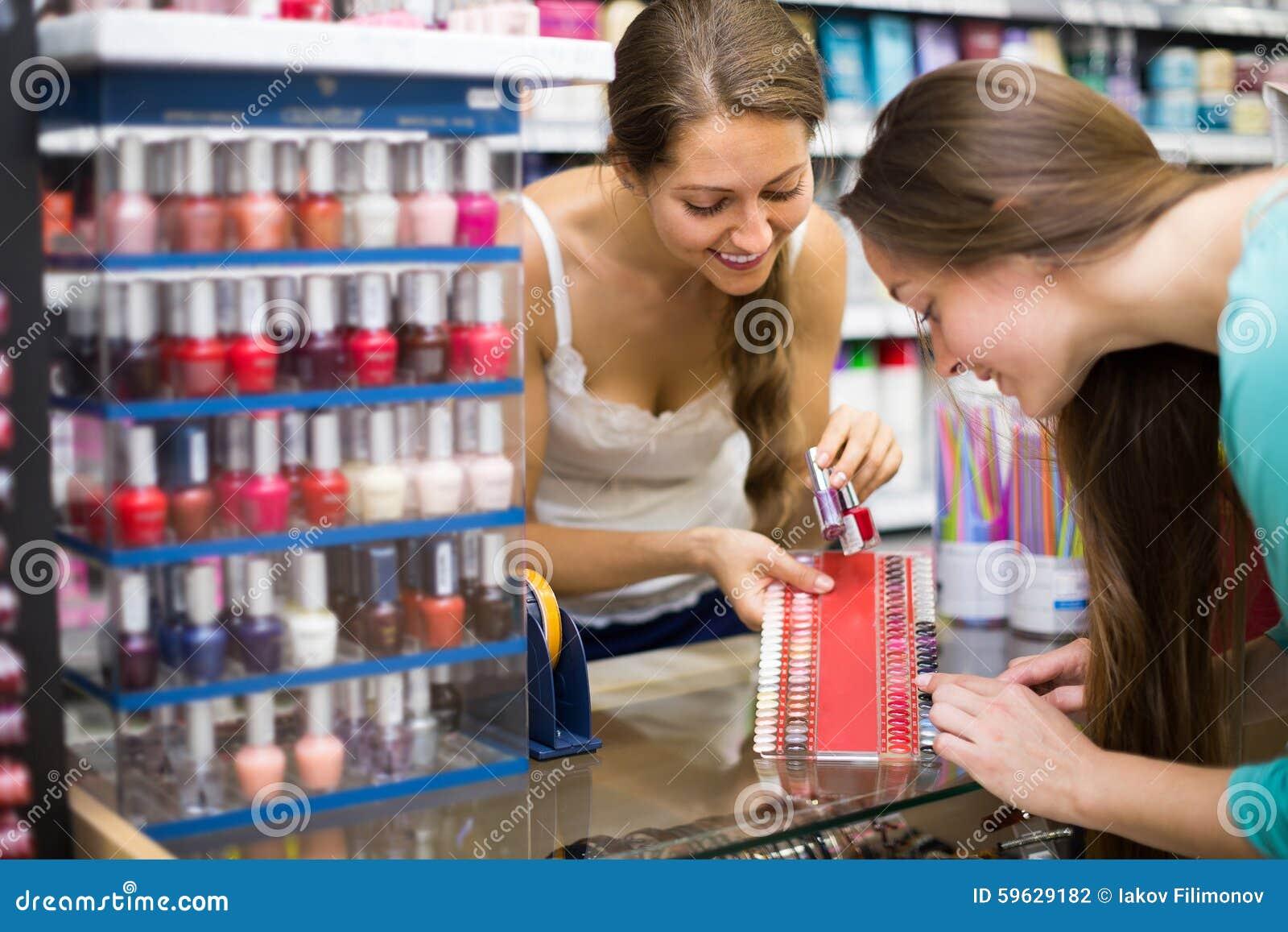 Girl Choosing Nail Polish At Store Stock Photo - Image of client ...