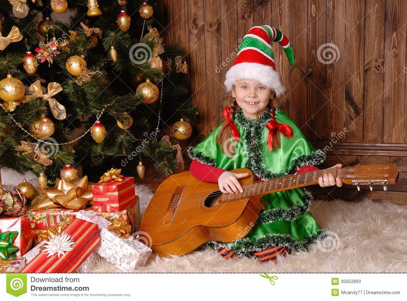 Girl the christmas elf with a guitar stock photos image 35052893