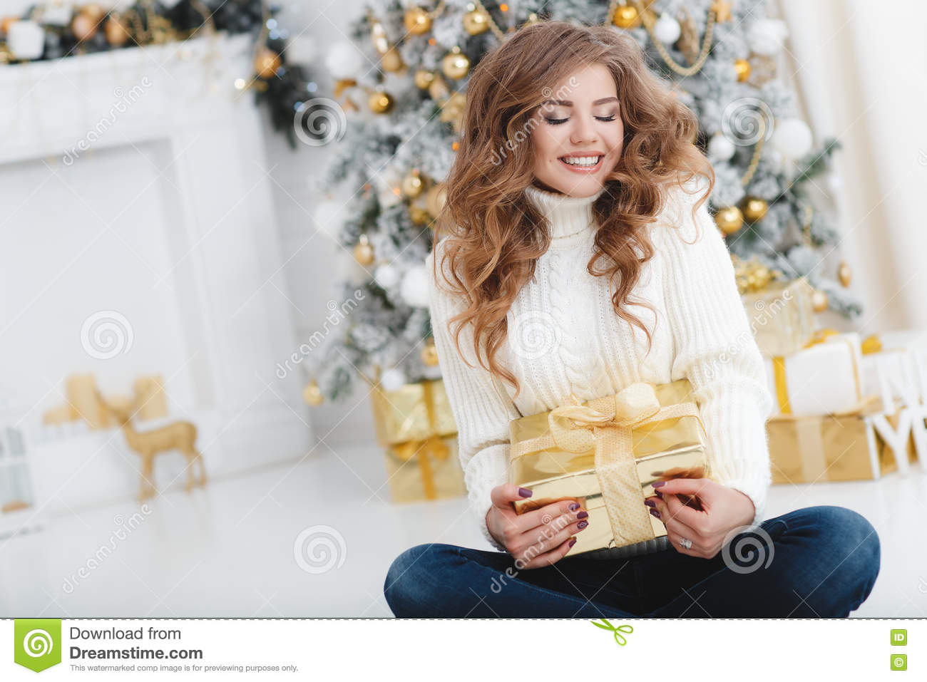 Girl With Christmas Gift Near Beautiful Dressed Christmas Tree Stock ...