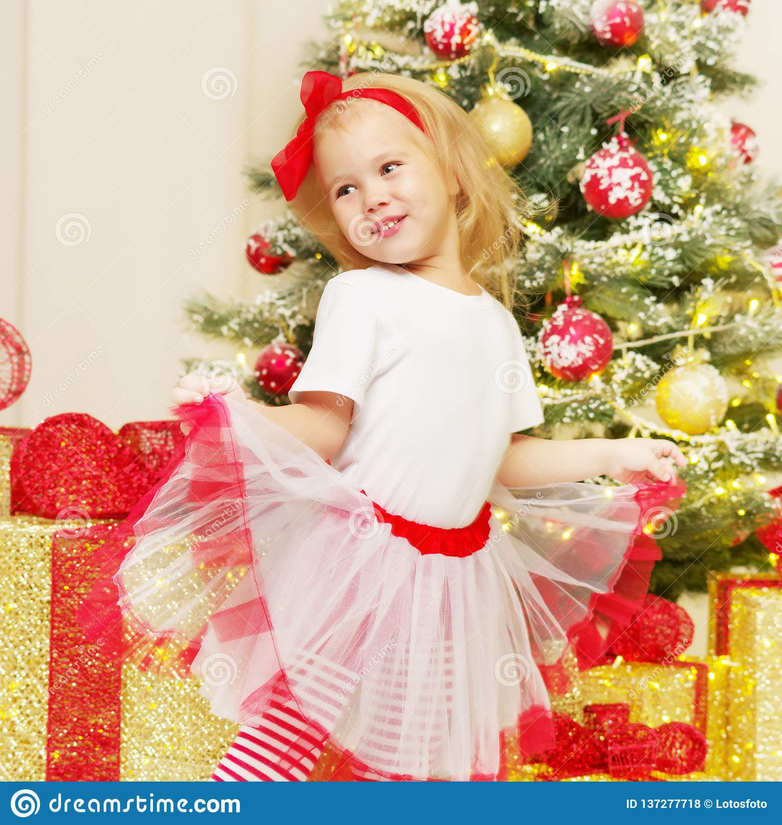 Little Girl Christmas Tree: The Girl At The Christmas Tree. Stock Photo